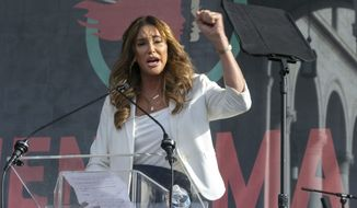 FILE - In this Jan. 18, 2020, file photo, Caitlyn Jenner speaks at the 4th Women's March in Los Angeles. In her four days as a candidate for California governor, Jenner had a twitter spat with a Democratic congressman, unveiled a website to sell campaign coffee mugs and swag and was photographed with a startup business owner. (AP Photo/Damian Dovarganes, File)