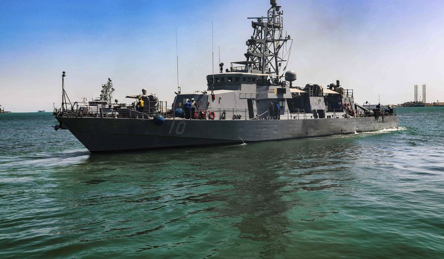 The USS Firebolt in Manama, Bahrain. The Firebolt fired warning shots when vessels of Iran's paramilitary Revolutionary Guard came too close to a recent patrol in the Persian Gulf, the U.S. Navy said Wednesday, April 28, 2021. (Spc. Cody Rich/U.S. Army via AP)