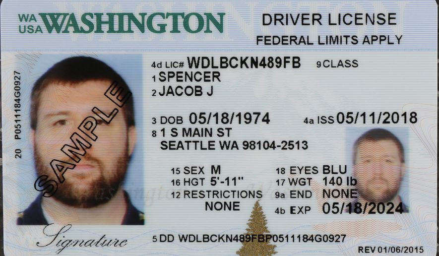 In this June 22, 2018, file photo a sample copy of a Washington driver's license is shown at the Washington state Dept. of Licensing office in Lacey, Wash. Americans will have more time because of the pandemic to get the Real ID that they will need to board a flight or enter federal facilities. The Department of Homeland Security on Tuesday, April 27, 2021, extended the Real ID deadline until May 3, 2023.  (AP Photo/Ted S. Warren, File)