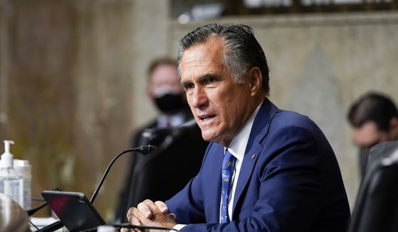 Sen. Mitt Romney, R-Utah, questions Zalmay Khalilzad, special envoy for Afghanistan Reconciliation, at the Senate Foreign Relations Committee on Capitol Hill in Washington, April 27, 2021, during a hearing on the Biden administration's Afghanistan policy and plans to withdraw troops after two decades of war. (AP Photo/Susan Walsh, Pool) ** FILE **