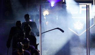 The Los Angeles Kings enter the ice at the start of the third period of an NHL hockey game against the Anaheim Ducks Monday, April 26, 2021, in Los Angeles. (AP Photo/Ashley Landis) **FILE**