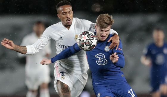 Chelsea's Timo Werner vies for the ball with Real Madrid's Eder Militao, left, during the Champions League semifinal first leg soccer match between Real Madrid and Chelsea at the Alfredo di Stefano stadium in Madrid, Spain, Tuesday, April 27, 2021. (AP Photo/Bernat Armangue)