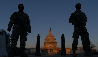 FILE - In this March 8, 2021, file photo, National Guard soldiers stand their posts around the Capitol at sunrise in Washington. Partisan tensions have only gotten worse on Capitol Hill since Pelosi's defiant act last year, days before the Senate acquitted Trump in his first impeachment trial. Since then, the Capitol has been through the Jan. 6 insurrection, another House impeachment and another Senate acquittal.  (AP Photo/Carolyn Kaster, File)