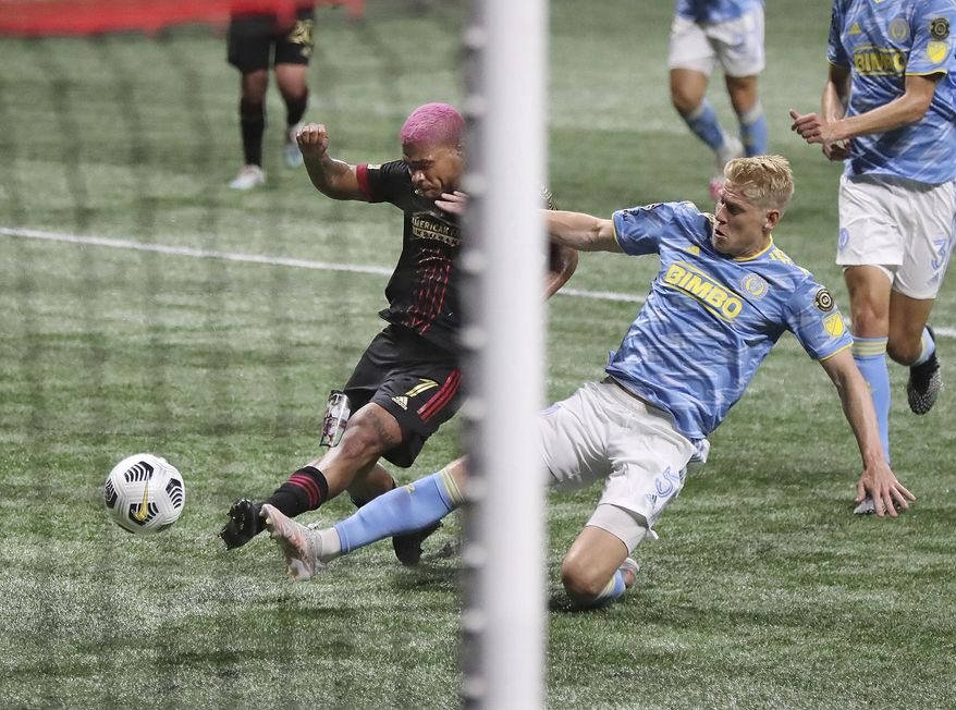Atlanta United forward Josef Martinez just misses a shot on goal with Philadelphia Union defender Jakob Glesnes helping deflect during a CONCACAF Champions League soccer match Tuesday, April 27, 2021, in Atlanta. (Curtis Compton/Atlanta Journal-Constitution via AP)