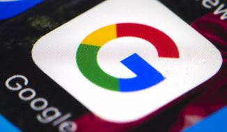 This April 26, 2017 file photo shows the Google mobile phone icon, in Philadelphia. Alphabet Inc., parent company of Google, reports financial results, Tuesday, April 27, 2021. Google's digital advertising network has shifted back into high gear after an unprecedented reversal during the early stages of the pandemic. (AP Photo/Matt Rourke)