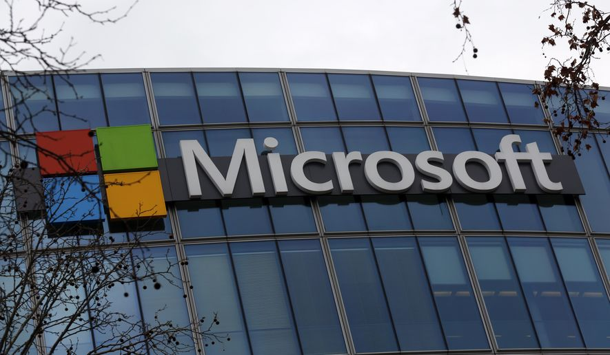 This Jan. 8, 2021 file photo shows the logo of Microsoft displayed outside the headquarters in Paris. (AP Photo/Thibault Camus, file)