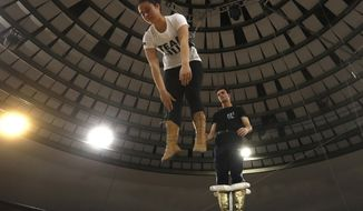 Kevin Richter and his sister Angelina practice as Kevin Richter's jumping group rehearses at the Capital Circus in Budapest, Hungary, April 20, 2021. A state of emergency was declared in Hungary only a day before the troupe was to begin its spring season last year, and pandemic restrictions limiting events and public gatherings have meant the circus hasn't brought in any income since.(AP Photo/Laszlo Balogh)
