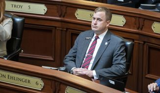 Rep. Aaron von Ehlinger, R-Lewiston, attends opening business as the Idaho House of Representatives convenes Wednesday, April 21, 2021 at the Statehouse in Boise, Idaho.   The Idaho lawmaker facing rape allegations from a 19-year-old intern was previously warned against hitting on women who work at the Statehouse after his colleagues heard complaints from other staffers, according to documents gathered by the Legislature's ethics committee and obtained by The Associated Press.  The Boise Police Department has a criminal investigation underway and the Legislature's Ethics Committee is scheduled to hold a public hearing on Wednesday, April 28.  (Darin Oswald/Idaho Statesman via AP)