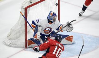 Washington Capitals right wing Daniel Sprong (10) scores a goal past New York Islanders goaltender Ilya Sorokin (30) during the first period of an NHL hockey game Tuesday, April 27, 2021, in Washington. (AP Photo/Nick Wass)