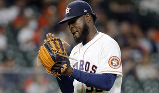 Houston Astros starting pitcher Cristian Javier reacts as he leaves the mound after striking out Seattle Mariners' Sam Haggerty during the seventh inning of a baseball game Tuesday, April 27, 2021, in Houston. (AP Photo/Michael Wyke)