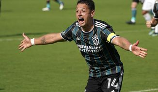 LA Galaxy forward Javier Hernandez (14) reacts after scoring a goal during the second half of an MLS soccer match against Inter Miami, Sunday, April 18, 2021, in Fort Lauderdale, Fla. (AP Photo/Lynne Sladky)