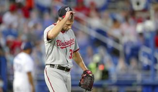 Washington Nationals starting pitcher Max Scherzer reacts after giving up a grand slam to Toronto Blue Jays' Vladimir Guerrero Jr. during the third inning of a baseball game Thursday, April 27, 2021, in Dunedin, Fla. (AP Photo/Mike Carlson)