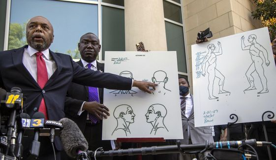 Attorneys for the family of Andrew Brown Jr., Wayne Kendall, left, and Ben Crump hold a news conference Tuesday, April 27, 2021, outside the Pasquotank County Public safety building in Elizabeth City, N.C., to announce results of the autopsy they commissioned. The attorneys say an independent autopsy shows that Brown, a Black man, was shot five times, including in the back of the head.  Brown was shot Wednesday by deputies serving drug-related search and arrest warrant. (Travis Long/The News & Observer via AP)