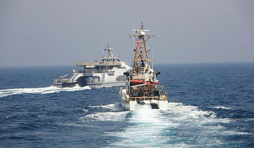 In an April 2, 2021, photo released by the U.S. Navy, an Iranian Revolutionary Guard vessel cut in front of the U.S. Coast Guard ship USCGC Monomoy in the Persian Gulf. American and Iranian warships had a tense encounter in the Persian Gulf earlier this month, the first such incident in about a year amid wider turmoil in the region over Tehran's tattered nuclear deal, the U.S. Navy said Tuesday, April 27, 2021. (U.S. Navy via AP) ** FILE **