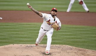 St. Louis Cardinals starting pitcher Carlos Martinez throws during the second inning of a baseball game against the Philadelphia Phillies Tuesday, April 27, 2021, in St. Louis. (AP Photo/Joe Puetz)