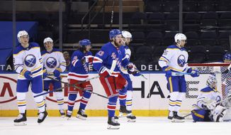 New York Rangers' Alexis Lafreniere (13) celebrates his goal against the Buffalo Sabres during the third period of an NHL hockey game Tuesday, April 27, 2021, in New York. (Bruce Bennett/Pool Photo via AP)