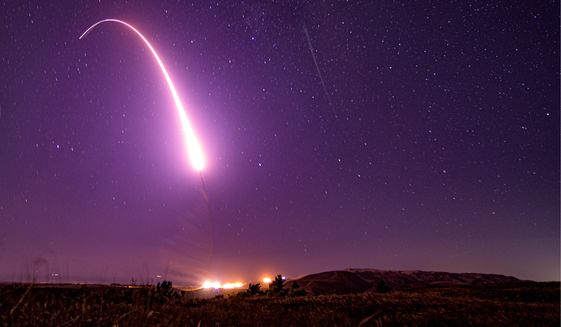 This image taken with a slow shutter speed on Oct. 2, 2019, and provided by the U.S. Air Force shows an unarmed Minuteman 3 intercontinental ballistic missile test launch at Vandenberg Air Force Base, Calif.  (Associated Press/File)  **FILE**