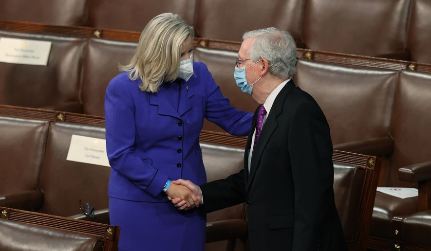 House Republican Conference Chairperson Rep. Liz Cheney, R-Wyo., shakes hands with Senate Minority Leader Mitch McConnell of Kentucky, on the House floor as they await President Joe Biden to arrive to address a joint session of Congress, Wednesday, April 28, 2021, in the House Chamber at the U.S. Capitol in Washington. (Jonathan Ernst/Pool via AP)