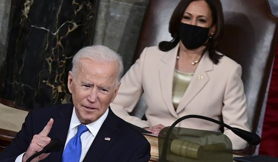 President Joe Biden addresses a joint session of Congress, Wednesday, April 28, 2021, in the House Chamber at the U.S. Capitol in Washington, as Vice President Kamala Harris look on. (Jim Watson/Pool via AP)
