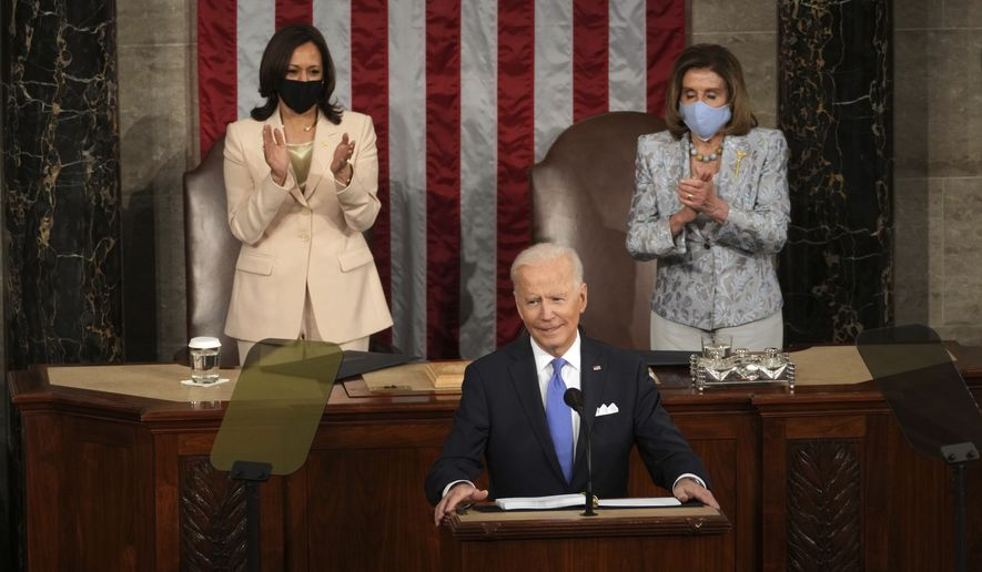 President Joe Biden speaks to a joint session of Congress Wednesday, April 28, 2021, in the House Chamber at the U.S. Capitol in Washington, as Vice President Kamala Harris and House Speaker Nancy Pelosi of Calif., watch. (Doug Mills/The New York Times via AP, Pool)