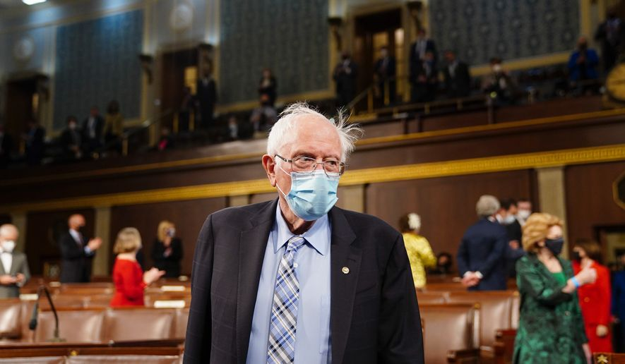 Sen. Bernie Sanders, I-Vt., arrives to the chamber ahead of President Joe Biden speaking to a joint session of Congress, Wednesday, April 28, 2021, in the House Chamber at the U.S. Capitol in Washington. (Melina Mara/The Washington Post via AP, Pool)