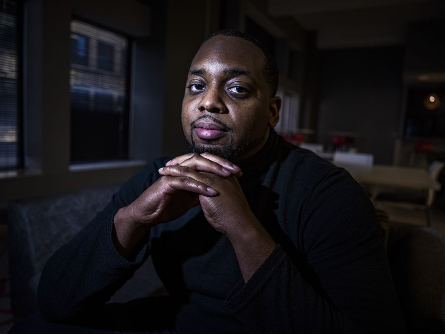 Brandon Mitchell, a juror in the trial of former Minneapolis police Officer Derek Chauvin for the killing of George Floyd, poses for a picture, Wednesday April 28, 2021, in Minneapolis. (Richard Tsong-Taatarii/Star Tribune via AP)