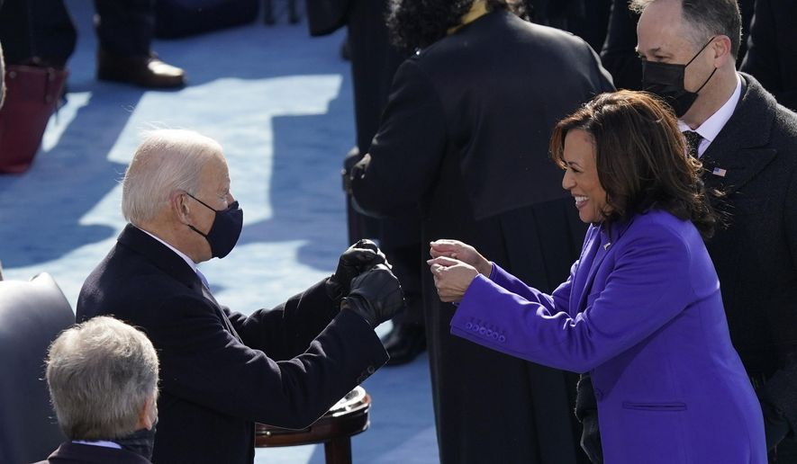 FILE - In this Jan. 20, 2021, file photo President-elect Joe Biden congratulates Vice President Kamala Harris after she was sworn in during the 59th Presidential Inauguration at the U.S. Capitol in Washington. Biden will mark his 100th day in office on Thursday, April 29. (AP Photo/Carolyn Kaster, File)