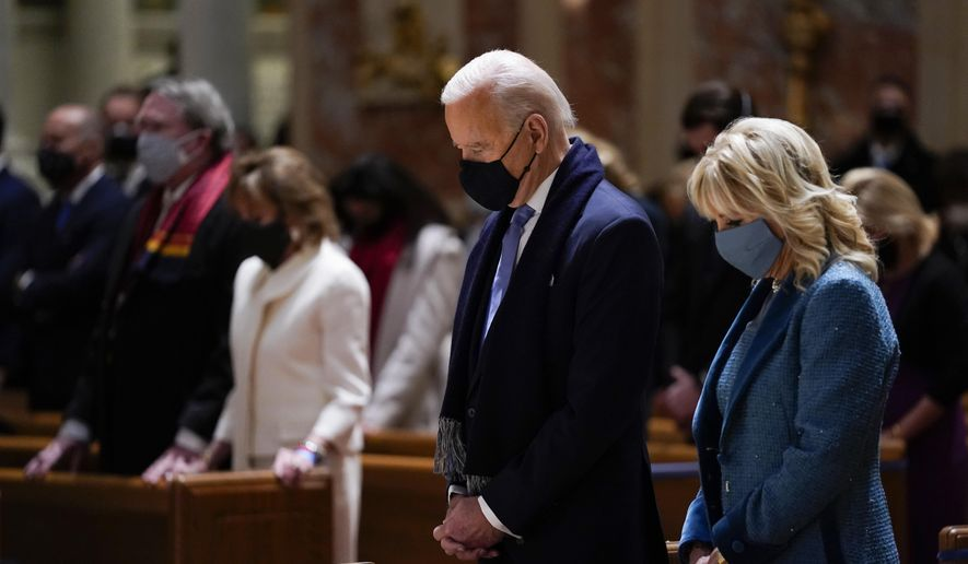 In this Wednesday, Jan. 20, 2021, photo, President-elect Joe Biden and his wife, Jill Biden, attend Mass at the Cathedral of St. Matthew the Apostle during Inauguration Day ceremonies in Washington. When U.S. Catholic bishops hold their next national meeting in June 2021, they'll be deciding whether to send a tougher-than-ever message to President Joe Biden and other Catholic politicians: Don't partake of Communion if you persist in public advocacy of abortion rights.(AP Photo/Evan Vucci) **FILE**
