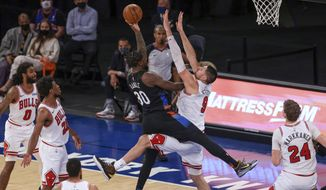 New York Knicks forward Julius Randle (30) shoots as Chicago Bulls center Nikola Vucevic (9) defends during the fourth quarter of an NBA basketball game Wednesday, April 28, 2021, in New York. (Vincent Carchietta/Pool Photo via AP)