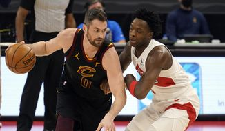 Cleveland Cavaliers forward Kevin Love (0) drives around Toronto Raptors forward OG Anunoby (3) during the first half of an NBA basketball game Monday, April 26, 2021, in Tampa, Fla. (AP Photo/Chris O'Meara) **FILE**