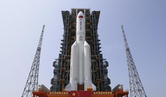 In this photo released by Xinhua News Agency, the core module of China's space station, Tianhe, on the the Long March-5B Y2 rocket is moved to the launching area of the Wenchang Spacecraft Launch Site in southern China's Hainan Province on April 23, 2021. (Guo Wenbin/Xinhua via AP) ** FILE **