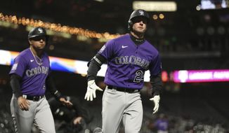 CORRECTS TO RYAN MCMAHON, INSTEAD OF C.J. CRON  - Colorado Rockies' Ryan McMahon heads back to the dugout after hitting a two-run home run against the San Francisco Giants during the 10th inning of a baseball game in San Francisco, Tuesday, April 27, 2021. (AP Photo/Jed Jacobsohn)