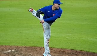 Chicago Cubs first baseman Anthony Rizzo (44) works as a relief pitcher in the seventh inning of a baseball game against the Atlanta Braves Wednesday, April 28, 2021, in Atlanta. (AP Photo/John Bazemore)