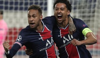PSG's Marquinhos, right, celebrates with PSG's Neymar after scoring his sides first goal during the Champions League semifinal first leg soccer match between Paris Saint Germain and Manchester City at the Parc des Princes stadium, in Paris, France , Wednesday, April 28, 2021. (AP Photo/Thibault Camus)