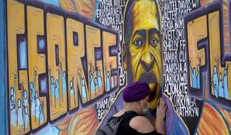 Damarra Atkins paid her respects to George Floyd at a mural at George Floyd Square, Friday, April 23, 2021, in Minneapolis. (AP Photo/Julio Cortez)