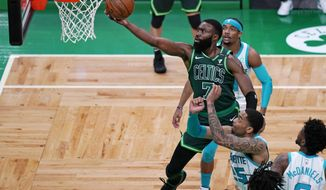 Boston Celtics guard Jaylen Brown (7) drives to the basket during the first half of an NBA basketball game against the Charlotte Hornets, Wednesday, April 28, 2021, in Boston. (AP Photo/Charles Krupa)