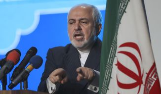 In this Feb. 23, 2021, file photo, Iran's Foreign Minister Mohammad Javad Zarif speaks at a conference in Tehran, Iran. Iran's top diplomat expressed regret Wednesday, April 28, 2021, that a recording leaked out of him making frank comments about the limits of his power in the Islamic Republic, while the country's president describing the incident as a means to derail ongoing talks with world powers over Tehran's tattered nuclear deal. (AP Photo/Vahid Salemi, File)