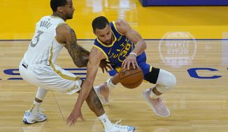 Golden State Warriors guard Stephen Curry, right, is defended by Dallas Mavericks guard Trey Burke during the first half of an NBA basketball game in San Francisco, Tuesday, April 27, 2021. (AP Photo/Jeff Chiu)
