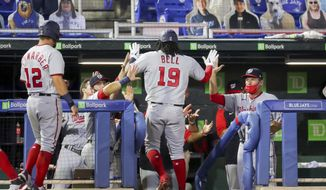 Washington Nationals' Josh Bell is congratulated on his two-run home run against the Toronto Blue Jays during the fifth inning of a baseball game Wednesday, April 28, 2021, in Dunedin, Fla. (AP Photo/Mike Carlson)