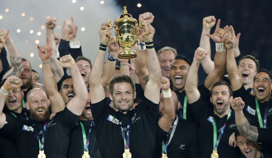 FILE - In this Oct. 31, 2015, file photo, New Zealand's captain Richie McCaw holds the trophy aloft after the Rugby World Cup final between New Zealand and Australia at Twickenham Stadium in London. The All Blacks won 34-17. New Zealand Rugby will face a momentous decision on the future of the All Blacks at its annual meeting Thursday, April 29, 2021, when it debates whether to sell a stake in the commercial value of the national team to American investors. (AP Photo/Christophe Ena, File)