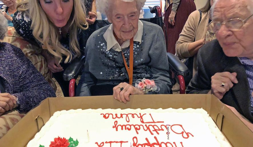 Thelma Sutcliffe is shown with a birthday cake in October 2019, in Omaha, Neb. Sutcliffe is now the oldest living American at 114 years old. (Mike Kelly/The World-Herald via AP)