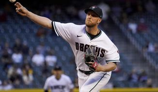 Arizona Diamondbacks starting pitcher Merrill Kelly throws against the San Diego Padres during the first inning of a baseball game, Tuesday, April 27, 2021, in Phoenix. (AP Photo/Matt York)