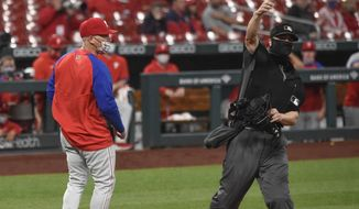Philadelphia Phillies manager Joe Girardi, left, is ejected by umpire Chris Segal during the sixth inning of the team's baseball game against the St. Louis Cardinals on Wednesday, April 28, 2021, in St. Louis. (AP Photo/Joe Puetz)