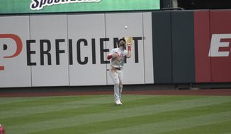Philadelphia Phillies right fielder Bryce Harper catches a fly ball during the second inning of a baseball game against the St. Louis Cardinals Tuesday, April 27, 2021, in St. Louis. (AP Photo/Joe Puetz)