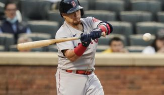 Boston Red Sox's Christian Vazquez hits an RBI double during the second inning of a baseball game against the New York Mets Wednesday, April 28, 2021, in New York. (AP Photo/Frank Franklin II)