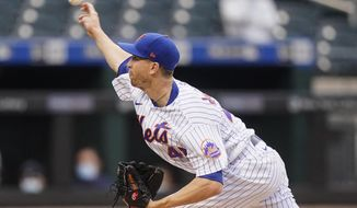 New York Mets' Jacob deGrom delivers a pitch during the first inning of a baseball game against the Boston Red Sox Wednesday, April 28, 2021, in New York. (AP Photo/Frank Franklin II)