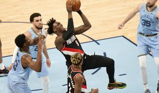 Portland Trail Blazers' Nassir Little (9) drives against Memphis Grizzlies defenders in the second half of an NBA basketball game Wednesday, April 28, 2021, in Memphis, Tenn. (AP Photo/Mark Humphrey)