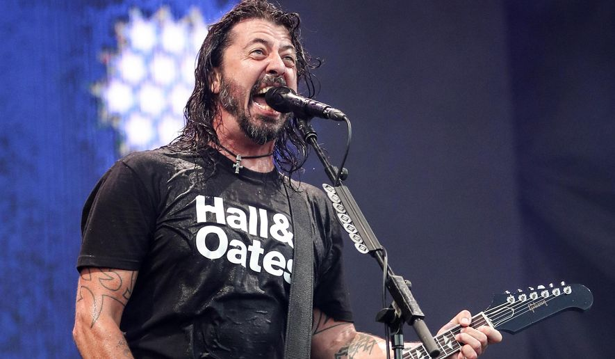 """FILE - Dave Grohl of Foo Fighters performs at Pilgrimage Music and Cultural Festival on Sept. 22, 2019, in Franklin, Tenn. The Rocker and filmmaker thought he was making a nostalgic documentary about the formative days of famous musicians, but then the pandemic happened. His new film """"What Drives Us"""" became a surprisingly emotional statement about the power of live music and its absence. (Photo by Al Wagner/Invision/AP, File)"""