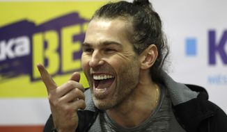 In this Thursday, Feb. 1, 2018, file photo, Jaromir Jagr smiles during a press conference at the Kladno Knights hockey club in Kladno, Czech Republic. Jaromir Jagr is ageless. On Thursday April 29, 2021, the 49-year-old had an assist on the way to his Kladno Knights's 5-2 victory over Jihlava to clinch their playoff series 4-3 and qualify for the top Czech league in next season. (AP Photo/Petr David Josek/ File) **FILE**