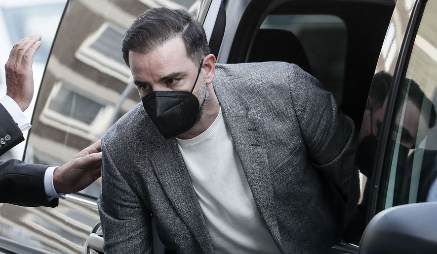 Germany's former national soccer player Christoph Metzelder arrives at the court for the opening of his trial in Duesseldorf, Germany, Thursday, April 29, 2021. The former defender of Borussia Dortmund, Real Madrid and Schalke 04 stands trial on charges of possession and distribution of child pornography. (AP Photo/Martin Meissner)